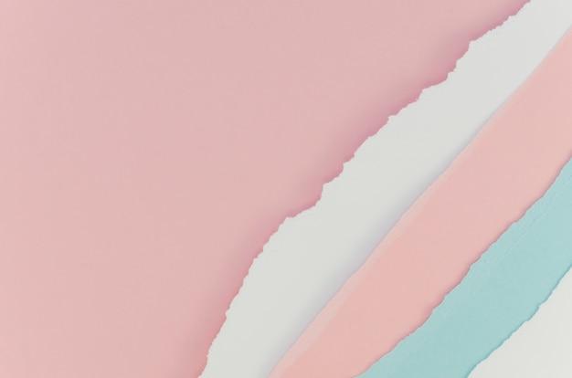 Carta strappata blu rosa e pastello