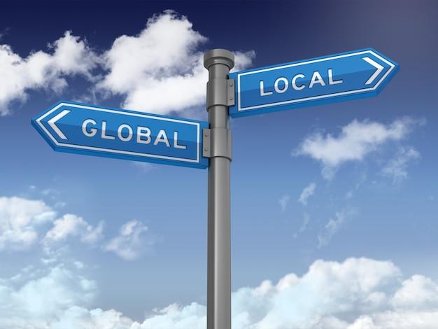 Cartello direzionale con parole locali globali su cielo blu