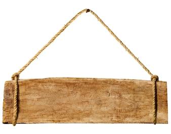 Cartello in legno appeso a un chiodo arrugginito.