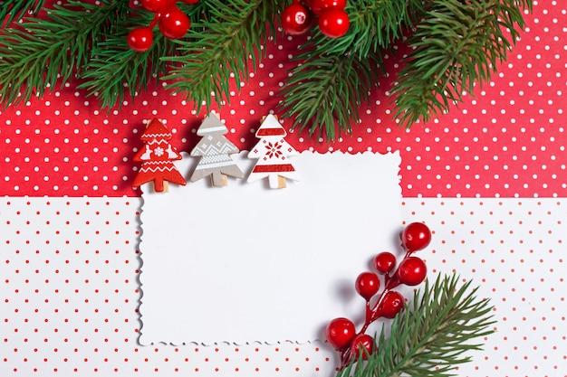 Cartolina d'auguri in bianco di natale con la decorazione
