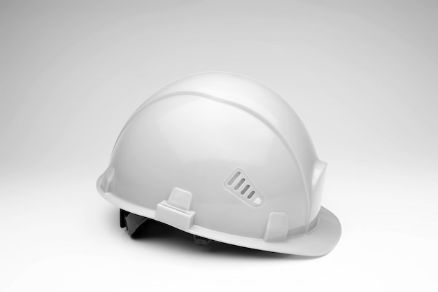 Casco da costruzione bianco. il concetto di architettura, costruzione, ingegneria, design. copia spazio