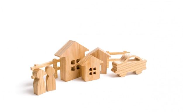 Case in legno, persone e auto su uno sfondo bianco.