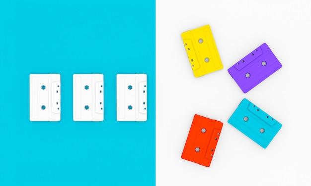 Cassette audio vintage di vari colori su blu e bianco