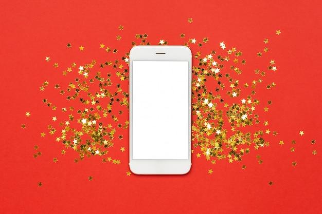 Cellulare con coriandoli di stelle dorate