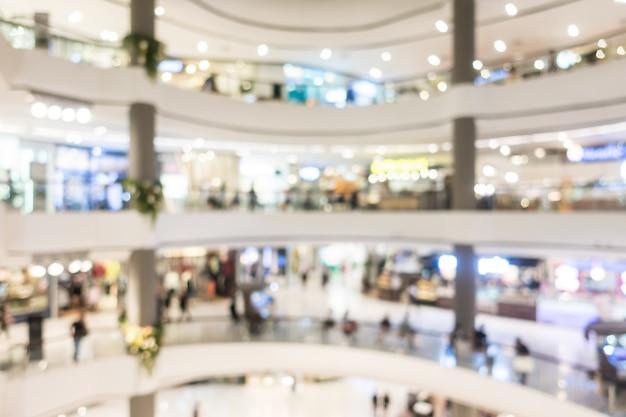 Centro commerciale astratto della sfuocatura e interno del negozio di vendite per fondo