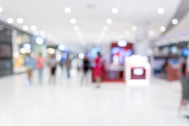 Centro commerciale astratto della sfuocatura e interno della vendita al dettaglio per fondo
