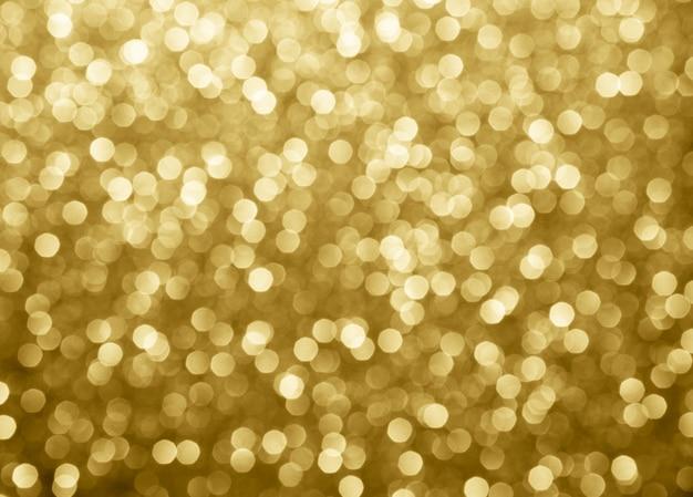 Cerchi astratti del bokeh del fondo dell'oro per natale