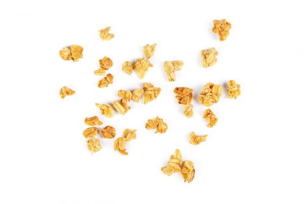 Cereale da prima colazione del granola dell'avena isolato su bianco