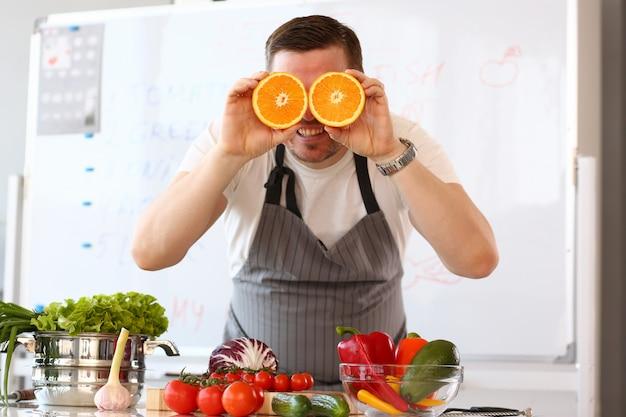 Chef vlogger showing comic orange citrus eye