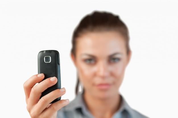 Chiuda in su del cellulare utilizzato per scattare una foto