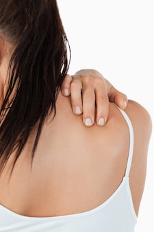 Chiuda in su del collo femminile doloroso