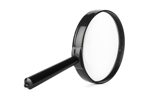 Chiuda in su della lente d'ingrandimento isolata su priorità bassa bianca