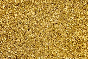 Chiuda in su della priorità bassa strutturata di scintillio dorato