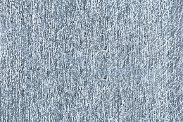 Chiuda in su di una struttura graffiata blu del muro di cemento