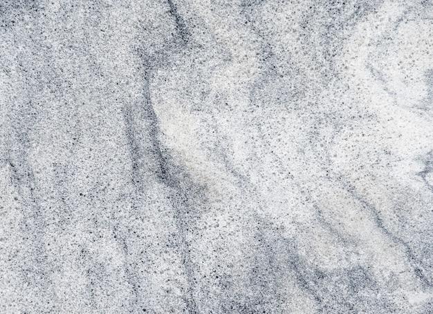 Chiuda sul bello modello grigio astratto di progettazione della roccia e della pietra di marmo per fondo