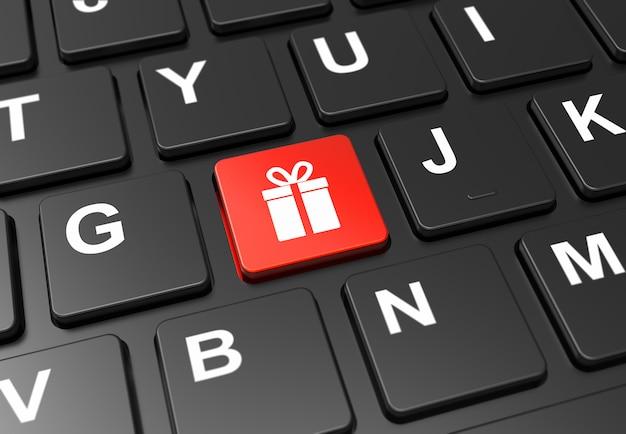 Chiuda sul bottone rosso con il segno del regalo sulla tastiera nera