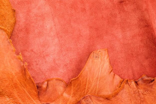 Chiuda sul fondo di struttura di cuoio sgualcito abbronzatura lacrima, divisione dei tessuti