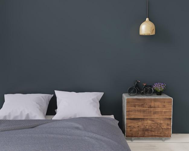 Chiuda sulla camera da letto moderna verde scuro con la credenza e la lampada