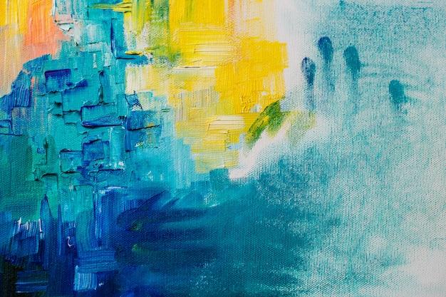 Chiuda sulla foto delle pitture ad olio sulla parete della tela