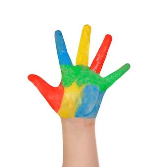 Chiuda sulla mano del bambino con molti colori