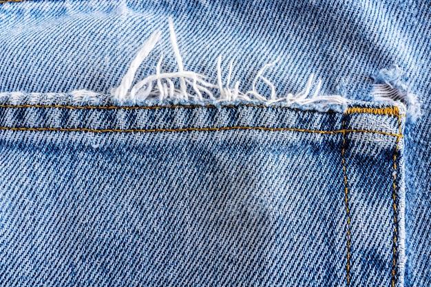 Chiuda sulla parte posteriore di vecchia struttura del jeans del denim.
