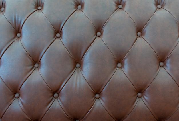 Chiuda sulla struttura dei cuoi del sofà