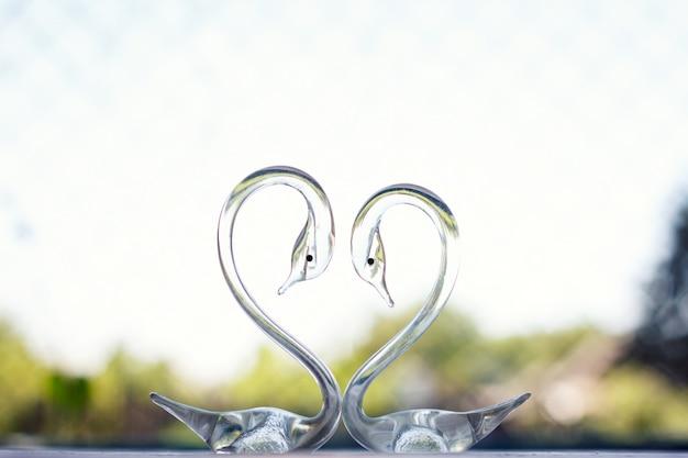 Cigni di cristallo, composizione d'amore