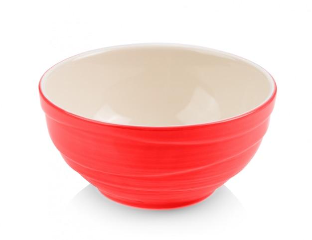 Ciotola rossa su superficie bianca