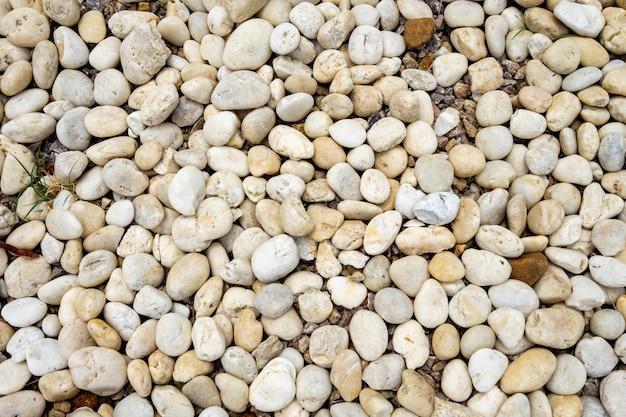 Ciottoli di pietra rotonda naturale sfondo