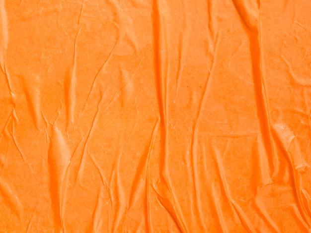 Close-up di carta arancione sullo sfondo