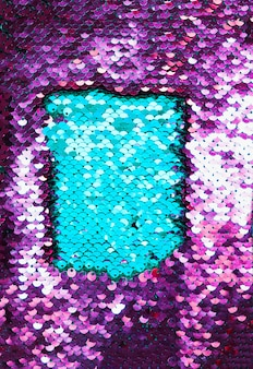 Close-up di tessuto paillettes blu e viola