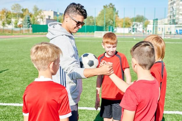 Coach motivating junior team