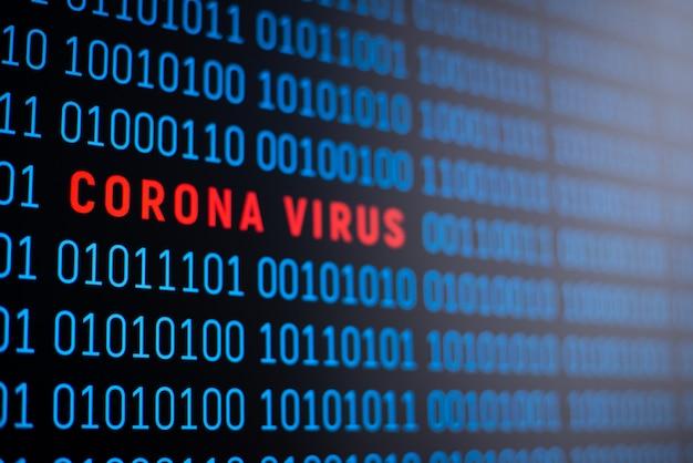 Codice binario sullo schermo del computer con scritta coronavirus al centro del codice. simbolo dell'epidemia di coronavirus