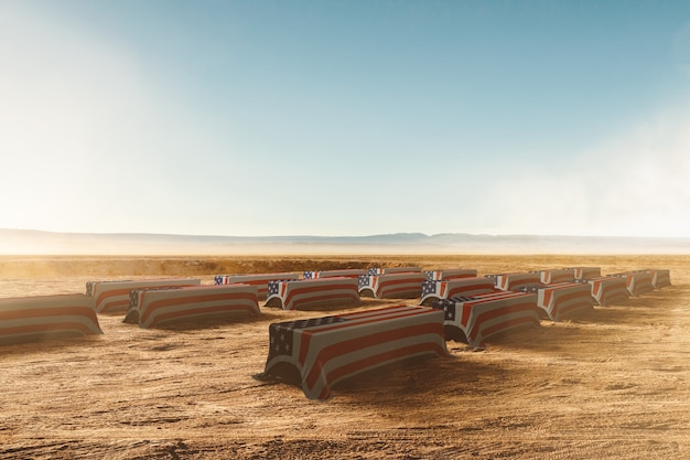 Cofani di soldati americani con bandiera americana nel deserto