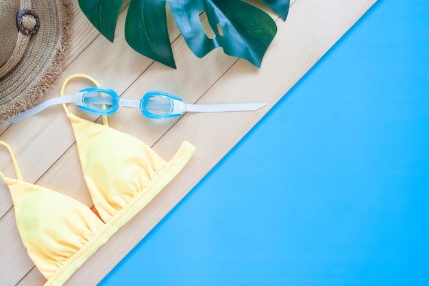 Collezione estiva, accessori da donna per nuotare sfondo. concetto di vacanza estiva