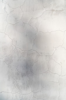 Colore bianco del muro di cemento incrinato in bianco per il fondo di struttura