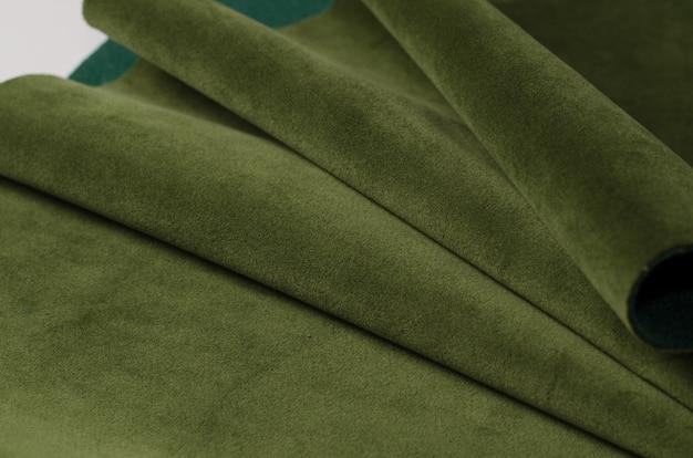 Colore brillante del campione tessile in velluto di alghe marine. trama del tessuto
