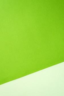 Colore delle tonalità pastello del fondale in carta verde. cornice, copia spazio. vuoto per il design.
