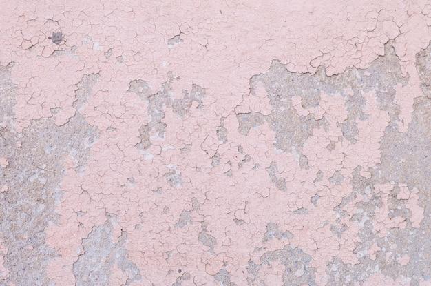 Colore pallido e sbucciatura del primo piano del fondo rosa dipinto di struttura della parete del cemento