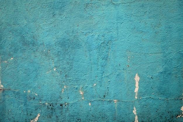 Colore verde del mare del muro di cemento di lerciume in bianco per struttura. sfondo vintage