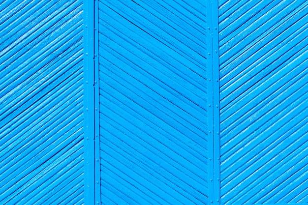 Colori blu del vecchio recinto misero di legno, fondo
