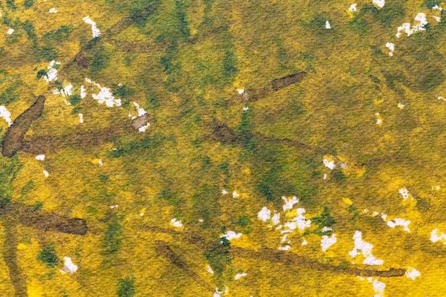 Colori giallo e verde scuro di sfondo di arte astratta, pittura ad acquerello su tela,
