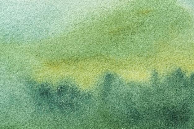 Colori verde oliva e verdi della luce di astrattismo. pittura ad acquerello su tela con sfumatura ciano tenue.