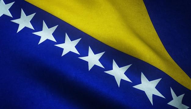 Colpo del primo piano della bandiera della bosnia ed erzegovina con strutture grungy