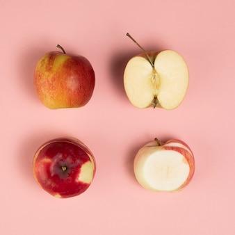 Colpo del primo piano delle mele sul fondo di plink