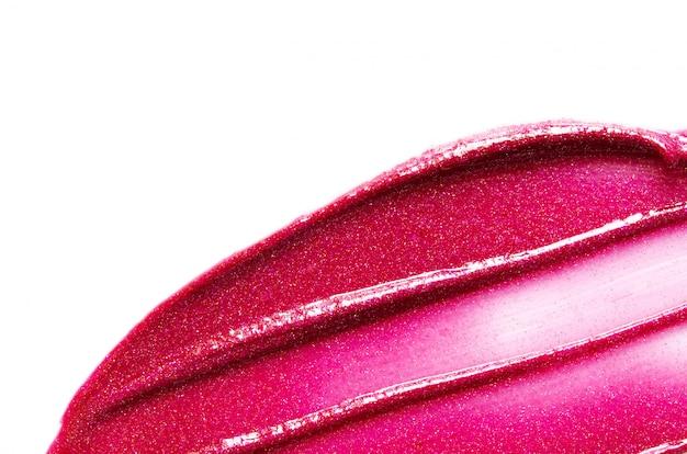 Colpo del rossetto isolato su fondo bianco. - immagine