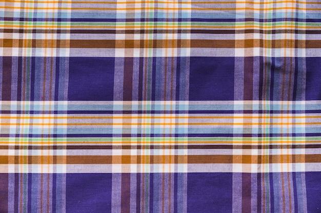 Colpo di telaio completo di tessile motivo a scacchi colorati