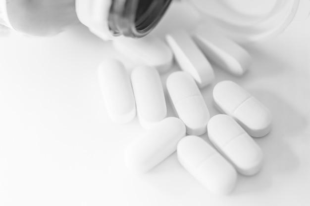 Compressa pulita bianca della medicina della farmacia della pillola bianca per fondo medico