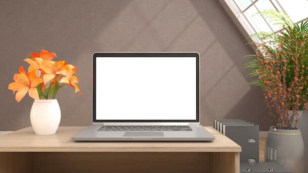 Computer con lo schermo bianco sul tavolo dell'ufficio