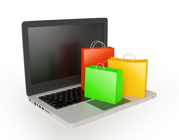 Computer portatile con borse della spesa